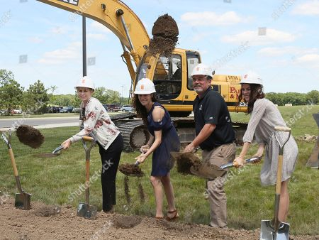 Stock Photo of The Nelson family, pictured from left to right, Natasha Lucke, Alissa Gander, Todd Nelson and Ashley Nelson, owners of Kalahari Resorts and Conventions, break ground at the company's expansion of the Pocono Mountains resort convention center on in Pocono Manor, Pa. Slated to open in 2019, the addition will more than double the size of the meeting facilities on site