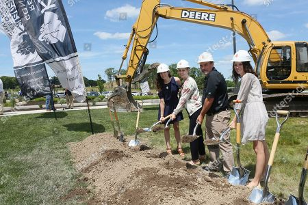 The Nelson family, pictured from left to right, Alissa Gander, Natasha Lucke, Todd Nelson and Ashley Nelson, owners of Kalahari Resorts and Conventions, break ground at the company's expansion of the Pocono Mountains resort convention center on in Pocono Manor, Pa. Slated to open in 2019, the addition will more than double the size of the meeting facilities on site