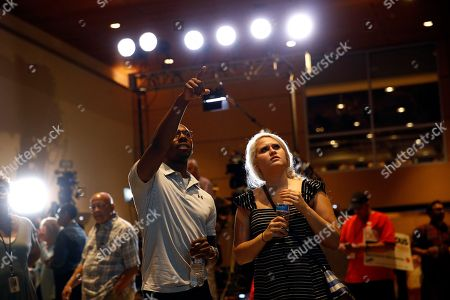 Tabitha Jackson, Dallas Matthews, Melania Trump. Dallas Matthews, left, and Tabitha Jackson, supporters of Maryland Democratic gubernatorial candidate Ben Jealous, watch voting results during an election night party, in Baltimore. Jealous and Prince George's County Executive Rushern Baker lead a crowded Democratic primary field to win a nomination to face popular Republican Gov. Larry Hogan in the fall
