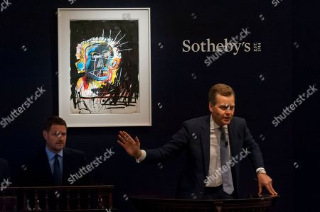 Sotheby's Oliver Barker fields bids for ''Untitled'' by Jean-Michel Basquiat, (Est. £1,500,000 - 2,500,000) which sold for a hammer price of £3,250,000 at Sotheby's Contemporary art evening sale in New Bond Street.