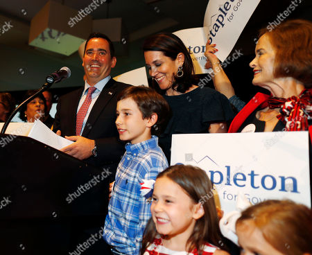 Stock Photo of Walker Stapleton, Jenna Stapleton, Colette Stapleton, Olivia Stapleton, Craig Stapleton. Flanked by his family, Walker Stapleton speaks after he won the Republican nomination to run for Colorado's governorship during an election night watch party in a hotel, in Greenwood Village, Colo. Stapleton secured the nomination Tuesday against businessmen Victor Mitchell, Doug Robinson and Greg Lopez