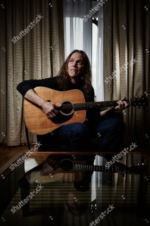 Stock Picture of London United Kingdom - February 6: Portrait Of American Musician Timothy B. Schmit Bassist And Vocalist With Rock Group The Eagles Photographed At Claridges In London On February 6