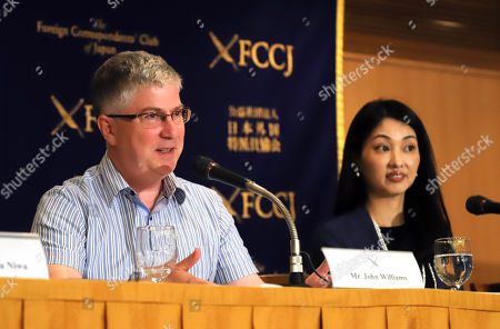 """Stock Image of British film director John Williams (L) of Sophia University professor and Japanese actress Rino Tsuneishi speak at a press conference for their latest movie """"The Trial"""" which will be screening on June 30 at the Foreign Correspondents' Club of Japan"""