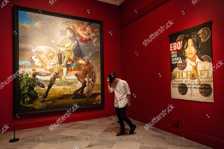 Painting titled Equestrian Portrait of King Philip II (Michael Jackson) (L) by Kehinde Wiley, 2010, and artwork titled Black Ebony II, 2010, by artist Lyle Ashton Harris is shown as part of the Michael Jackson: On the Wall exhibition at the National Portrait Gallery.