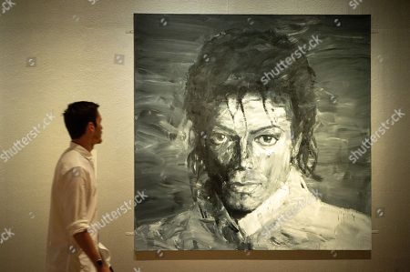 Painting titled In memory of Michael Jackson 1958-2009 (2017) by artist Yan Pei-Ming is shown as part of the Michael Jackson: On the Wall exhibition at the National Portrait Gallery.