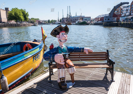 """""""Long John Wallace"""" character at the Gromit Unleashed 2, official launch at Bristol Harbourside. Gromit Unleashed 2 will see the Academy Award®-winning character Gromit by Nick Park at Aardman Animations returning to Bristol in 2018 for the second time on sculpture trails to raise money for  the Grand Appeal charity. The character of Gromit will be joined by Wallace and arch nemesis Feathers McGraw."""