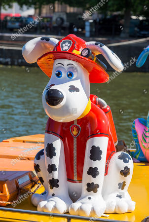 """""""Marshall"""" Gromit character at the Gromit Unleashed 2, official launch at Bristol Harbourside. Gromit Unleashed 2 will see the Academy Award®-winning character Gromit by Nick Park at Aardman Animations returning to Bristol in 2018 for the second time on sculpture trails to raise money for  the Grand Appeal charity. The character of Gromit will be joined by Wallace and arch nemesis Feathers McGraw."""