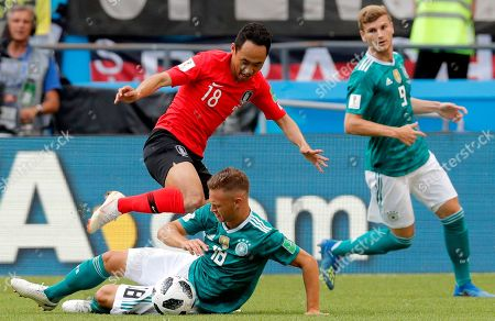 Joshua Kimmich (down) of Germany and Moon Seon-min of South Korea in action during the FIFA World Cup 2018 group F preliminary round soccer match between South Korea and Germany in Kazan, Russia, 27 June 2018. (RESTRICTIONS APPLY: Editorial Use Only, not used in association with any commercial entity - Images must not be used in any form of alert service or push service of any kind including via mobile alert services, downloads to mobile devices or MMS messaging - Images must appear as still images and must not emulate match action video footage - No alteration is made to, and no text or image is superimposed over, any published image which: (a) intentionally obscures or removes a sponsor identification image; or (b) adds or overlays the commercial identification of any third party which is not officially associated with the FIFA World Cup)