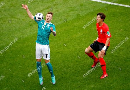 Marco Reus of Germany and Yun Young-sun of South Korea