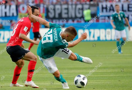 Moon Seon-min (L) of South Korea and Joshua Kimmich of Germany in action during the FIFA World Cup 2018 group F preliminary round soccer match between South Korea and Germany in Kazan, Russia, 27 June 2018. (RESTRICTIONS APPLY: Editorial Use Only, not used in association with any commercial entity - Images must not be used in any form of alert service or push service of any kind including via mobile alert services, downloads to mobile devices or MMS messaging - Images must appear as still images and must not emulate match action video footage - No alteration is made to, and no text or image is superimposed over, any published image which: (a) intentionally obscures or removes a sponsor identification image; or (b) adds or overlays the commercial identification of any third party which is not officially associated with the FIFA World Cup)