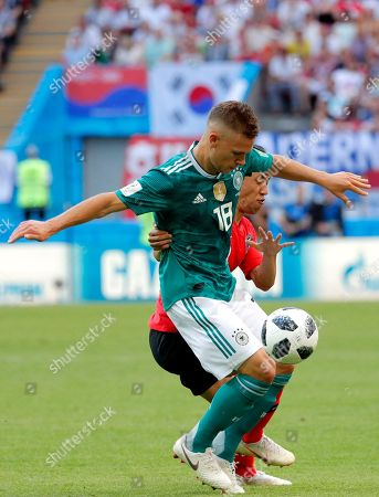 Moon Seon-min (back) of South Korea and Joshua Kimmich of Germany in action during the FIFA World Cup 2018 group F preliminary round soccer match between South Korea and Germany in Kazan, Russia, 27 June 2018. (RESTRICTIONS APPLY: Editorial Use Only, not used in association with any commercial entity - Images must not be used in any form of alert service or push service of any kind including via mobile alert services, downloads to mobile devices or MMS messaging - Images must appear as still images and must not emulate match action video footage - No alteration is made to, and no text or image is superimposed over, any published image which: (a) intentionally obscures or removes a sponsor identification image; or (b) adds or overlays the commercial identification of any third party which is not officially associated with the FIFA World Cup)
