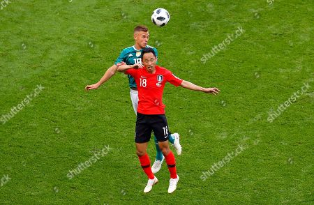 Joshua Kimmich of Germany and Moon Seon-min of South Korea