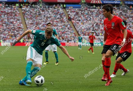 South Korea's Yun Young-sun, right, challenges for the ball with Germany's Timo Werner, left, during the group F match between South Korea and Germany, at the 2018 soccer World Cup in the Kazan Arena in Kazan, Russia
