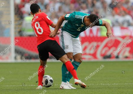 Germany's Sami Khedira, right, challenges for the ball with South Korea's Moon Seon-min, left, during the group F match between South Korea and Germany, at the 2018 soccer World Cup in the Kazan Arena in Kazan, Russia
