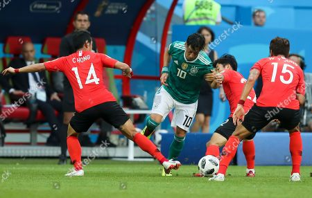 From left, South Korea's Hong Chul, Germany's Mesut Ozil, and South Korea's Go Yo-han and Jung Woo-young fight for the ball during the group F match between South Korea and Germany, at the 2018 soccer World Cup in the Kazan Arena in Kazan, Russia