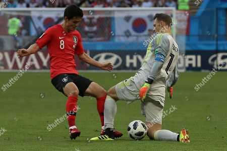 South Korea's Ju Se-jong, left, and Germany goalkeeper Manuel Neuer fight for the ball during the group F match between South Korea and Germany, at the 2018 soccer World Cup in the Kazan Arena in Kazan, Russia
