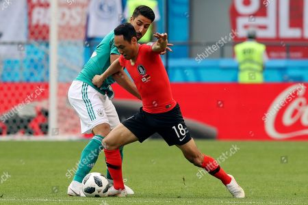 Germany's Sami Khedira, left, and South Korea's Moon Seon-min fight for the ball during the group F match between South Korea and Germany, at the 2018 soccer World Cup in the Kazan Arena in Kazan, Russia