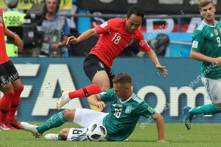South Korea's Moon Seon-min, top, and Germany's Joshua Kimmich fight for the ball during the group F match between South Korea and Germany, at the 2018 soccer World Cup in the Kazan Arena in Kazan, Russia