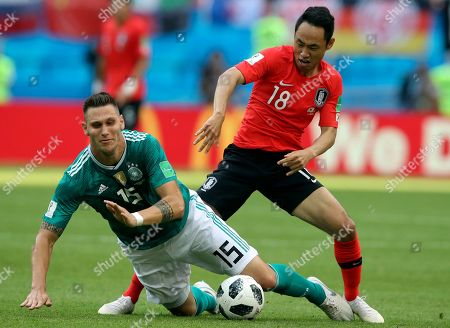 Germany's Niklas Suele, left, and South Korea's Moon Seon-min fight for the ball during the group F match between South Korea and Germany, at the 2018 soccer World Cup in the Kazan Arena in Kazan, Russia