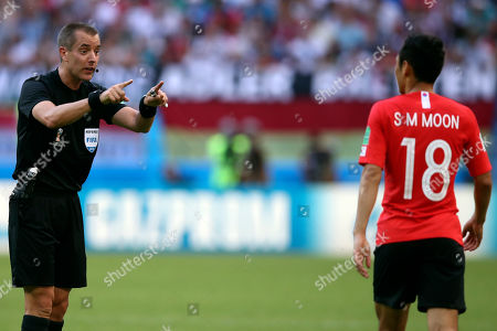 Referee Mark Geiger from the US talks with South Korea's Moon Seon-min during the group F match between South Korea and Germany, at the 2018 soccer World Cup in the Kazan Arena in Kazan, Russia