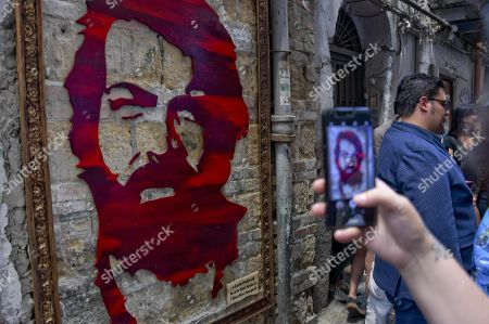 Stock Image of A view of a portrait dedicated to late Italian actor Carlo Pedersoli during the ceremony of its unveiling inside Qauartieri Sagnoli (Spanish quarters) in Naples, Italy, 27 June 2018. The actor is better known by his screen name Bud Spencer who died on 27 June 2016 in Rome.