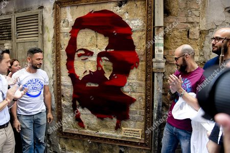 Stock Photo of A view of a portrait dedicated to late Italian actor Carlo Pedersoli during the ceremony of its unveiling inside Qauartieri Sagnoli (Spanish quarters) in Naples, Italy, 27 June 2018. The actor is better known by his screen name Bud Spencer who died on 27 June 2016 in Rome.
