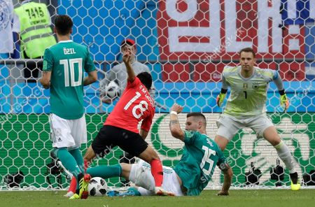 Germany's Niklas Suele, 2nd right, challenges for the ball South Korea's Moon Seon-min, 2nd left, during the group F match between South Korea and Germany, at the 2018 soccer World Cup in the Kazan Arena in Kazan, Russia