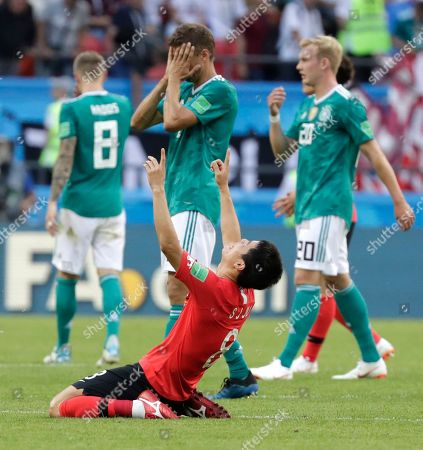 Germany's players walk off the pitch as South Korea's Ju Se-jong, front celebrates after the group F match between South Korea and Germany, at the 2018 soccer World Cup in the Kazan Arena in Kazan, Russia