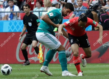 Germany's Sami Khedira, left, challenges for the ball South Korea's Moon Seon-min, right, during the group F match between South Korea and Germany, at the 2018 soccer World Cup in the Kazan Arena in Kazan, Russia