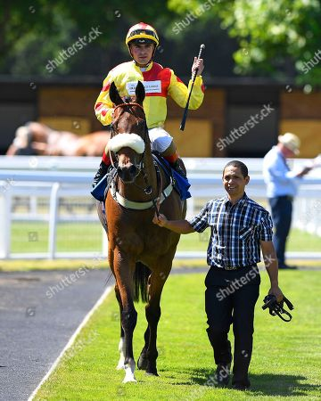 Winner of The Inspire Foundation Veterans' Handicap   Rio Ronaldo ridden by Adrea Atzeni and trained by Mike Murphy is led into the winners enclosure during Whitsbury Manor Stud Bibury Cup Day Racing at Salisbury Racecourse on 27th June 2018