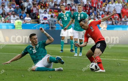 Germany's Niklas Suele, left, and South Korea's Moon Seon-min challenge for the ball during the group F match between South Korea and Germany, at the 2018 soccer World Cup in the Kazan Arena in Kazan, Russia