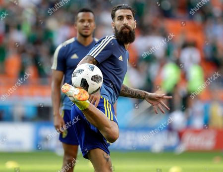 Sweden's Jimmy Durmaz plays the ball as he warms up prior to the group F match between Mexico and Sweden, at the 2018 soccer World Cup in the Yekaterinburg Arena in Yekaterinburg, Russia