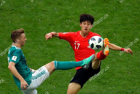 Germany's Marco Reus vies for the ball with South Korea's Lee Jae-sung during the group F match between South Korea and Germany, at the 2018 soccer World Cup in the Kazan Arena in Kazan, Russia
