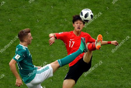 Germany's Marco Reus vies for the ball with South Korea's Lee Jae-sung, right, during the group F match between South Korea and Germany, at the 2018 soccer World Cup in the Kazan Arena in Kazan, Russia
