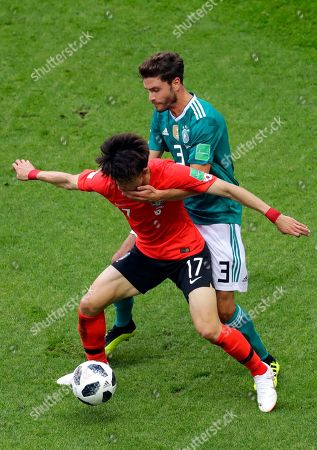 Germany's Jonas Hector fights for the ball with South Korea's Lee Jae-sung, left, during the group F match between South Korea and Germany, at the 2018 soccer World Cup in the Kazan Arena in Kazan, Russia