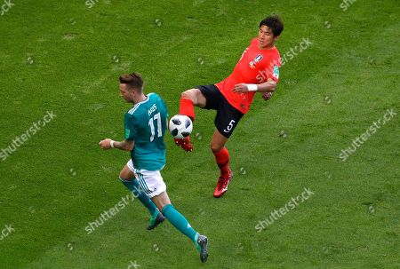 Stock Image of Germany's Marco Reus, left, vies for the ball with South Korea's Yun Young-sun during the group F match between South Korea and Germany, at the 2018 soccer World Cup in the Kazan Arena in Kazan, Russia