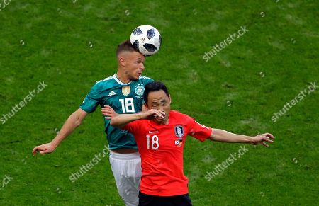 Stock Picture of Germany's Joshua Kimmich, left, jumps for the ball with South Korea's Moon Seon-min during the group F match between South Korea and Germany, at the 2018 soccer World Cup in the Kazan Arena in Kazan, Russia