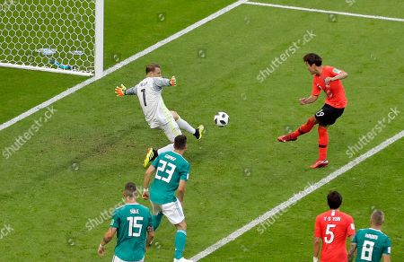 South Korea's Kim Young-gwon, top right, scores the opening goal during the group F match between South Korea and Germany, at the 2018 soccer World Cup in the Kazan Arena in Kazan, Russia