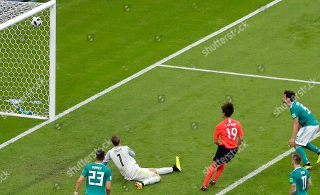 South Korea's Kim Young-gwon, 3rd right, scores the opening goal during the group F match between South Korea and Germany, at the 2018 soccer World Cup in the Kazan Arena in Kazan, Russia