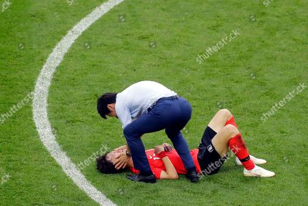 South Korea's head coach Shin Tae-yong celebrates with Lee Jae-sung at the end of the group F match between South Korea and Germany, at the 2018 soccer World Cup in the Kazan Arena in Kazan, Russia