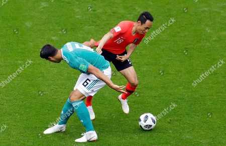 Germany's Sami Khedira fights for the ball with South Korea's Moon Seon-min, right, during the group F match between South Korea and Germany, at the 2018 soccer World Cup in the Kazan Arena in Kazan, Russia