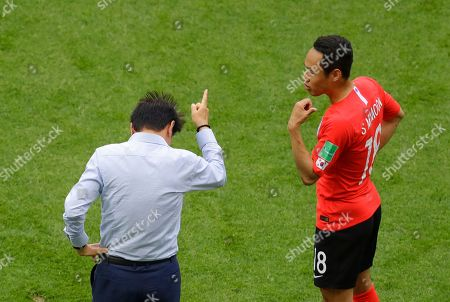 South Korea's head coach Shin Tae-yong gestures to South Korea's Moon Seon-min during the group F match between South Korea and Germany, at the 2018 soccer World Cup in the Kazan Arena in Kazan, Russia