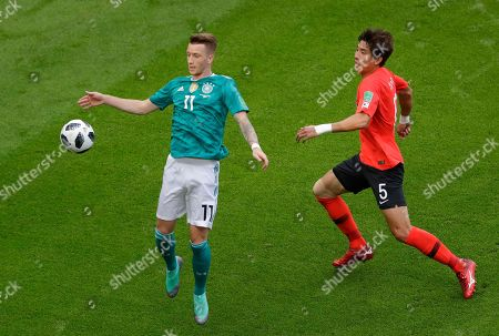 Germany's Marco Reus celebrates after scoring in front of South Korea's Yun Young-sun, right, during the group F match between South Korea and Germany, at the 2018 soccer World Cup in the Kazan Arena in Kazan, Russia