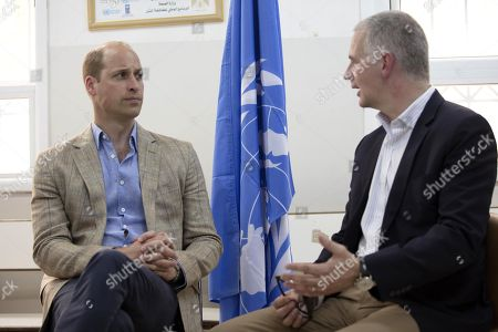 Britain's Prince William receives a briefing by the Director of UNRWA Operations in the West Bank, Scott Anderson during a visit to a clinic operated by UNRWA inside Al-Jalzoun refugee camp near the West Bank city of Ramallah
