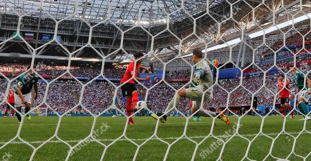 South Korea's Kim Young-gwon scores his side's opening goal during the group F match between South Korea and Germany, at the 2018 soccer World Cup in the Kazan Arena in Kazan, Russia