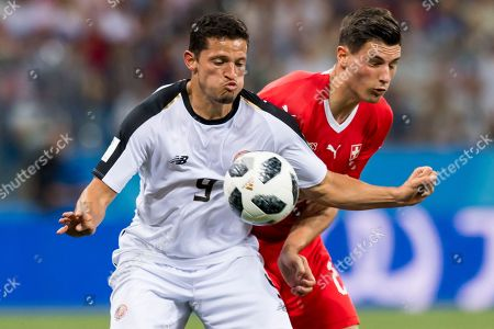Costa Rica's midfielder Daniel Colindres (L) fights for the ball with Switzerland's defender Fabian Schaer during the FIFA World Cup 2018 group E preliminary round soccer match between Switzerland and Costa Rica in Nizhny Novgorod, Russia, 27 June 2018. (RESTRICTIONS APPLY: Editorial Use Only, not used in association with any commercial entity - Images must not be used in any form of alert service or push service of any kind including via mobile alert services, downloads to mobile devices or MMS messaging - Images must appear as still images and must not emulate match action video footage - No alteration is made to, and no text or image is superimposed over, any published image which: (a) intentionally obscures or removes a sponsor identification image; or (b) adds or overlays the commercial identification of any third party which is not officially associated with the FIFA World Cup)