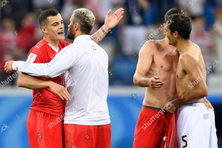 From left, Switzerland's midfielder Granit Xhaka, Switzerland's midfielder Valon Behrami and Switzerland's defender Fabian Schaer react next to Costa Rica's midfielder Celso Borges, right, after the FIFA World Cup 2018 group E preliminary round soccer match between Switzerland and Costa Rica in Nizhny Novgorod, Russia, 27 June 2018. (RESTRICTIONS APPLY: Editorial Use Only, not used in association with any commercial entity - Images must not be used in any form of alert service or push service of any kind including via mobile alert services, downloads to mobile devices or MMS messaging - Images must appear as still images and must not emulate match action video footage - No alteration is made to, and no text or image is superimposed over, any published image which: (a) intentionally obscures or removes a sponsor identification image; or (b) adds or overlays the commercial identification of any third party which is not officially associated with the FIFA World Cup)