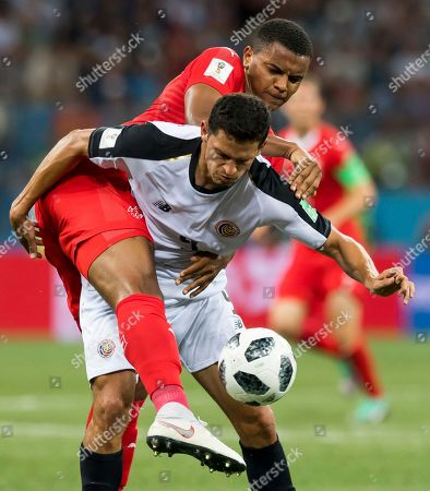 Switzerland's defender Manuel Akanji (L) fights for the ball with Costa Rica's midfielder Daniel Colindres during the FIFA World Cup 2018 group E preliminary round soccer match between Switzerland and Costa Rica in Nizhny Novgorod, Russia, 27 June 2018. (RESTRICTIONS APPLY: Editorial Use Only, not used in association with any commercial entity - Images must not be used in any form of alert service or push service of any kind including via mobile alert services, downloads to mobile devices or MMS messaging - Images must appear as still images and must not emulate match action video footage - No alteration is made to, and no text or image is superimposed over, any published image which: (a) intentionally obscures or removes a sponsor identification image; or (b) adds or overlays the commercial identification of any third party which is not officially associated with the FIFA World Cup)