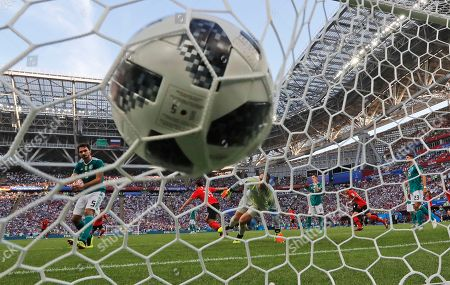 Germany goalkeeper Manuel Neuer reacts after South Korea's Kim Young-gwon, 3rd from left, scored his side's opening goal during the group F match between South Korea and Germany, at the 2018 soccer World Cup in the Kazan Arena in Kazan, Russia