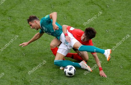 Germany's Leon Goretzka fights for the ball with South Korea's Lee Jae-sung, right, during the group F match between South Korea and Germany, at the 2018 soccer World Cup in the Kazan Arena in Kazan, Russia